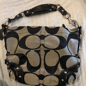 Coach tan black shoulder bag some wear in fabric